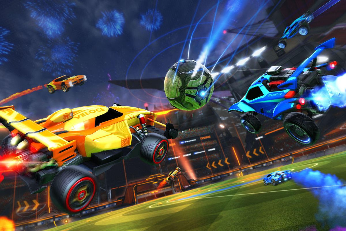 Rocket League - yellow, blue, and orange cars attacking the ball