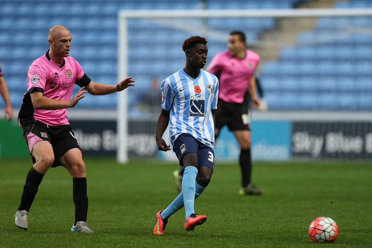 Bassala Sambou of Coventry City plays the ball watched by Jason Taylor of Northampton Town during The Emirates FA Cup First Round match