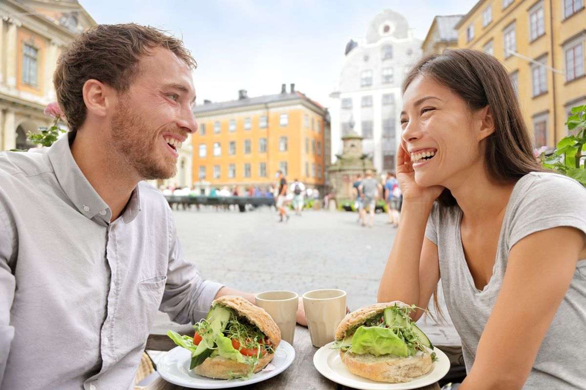 A happy couple eating in Stockholm, Sweden.