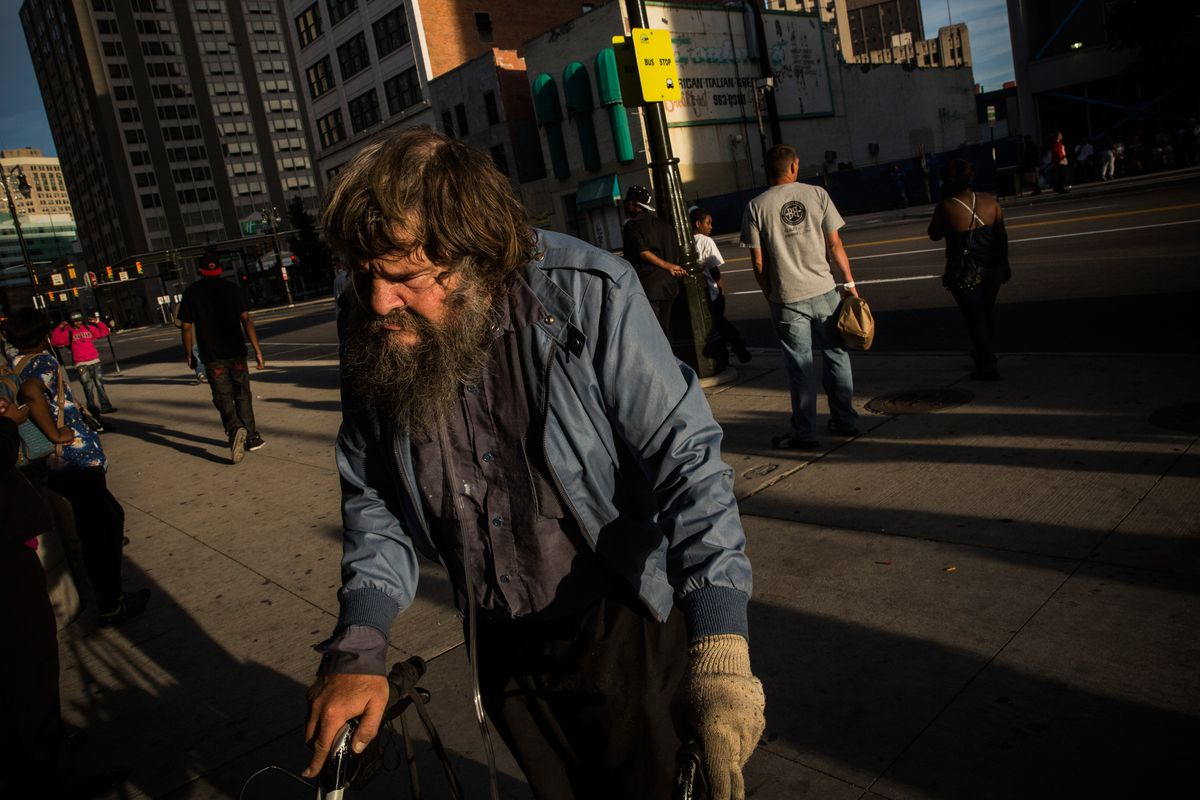 A man waits for a bus in Detroit, one of the US cities hardest-hit by poverty.