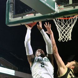 James Thompson reaching for a basket.