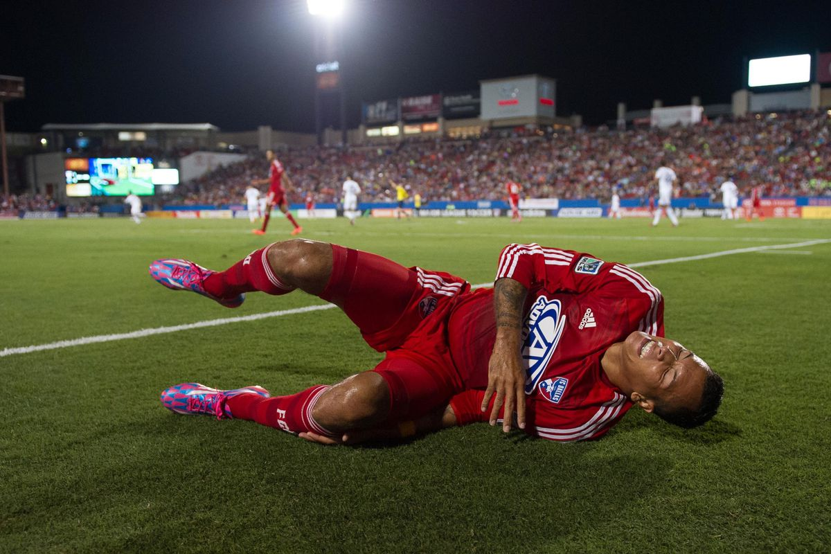 Dallas striker Blas Perez helps the referee count down the final minutes at Toyota Stadium in Frisco, Texas.