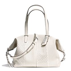 """<a href=""""http://f.curbed.cc/f/Coach_031014_BleeckerSatchel"""">Bleecker Copper Satchel in Silver/Parchment Perforated Leather</a>, $358"""
