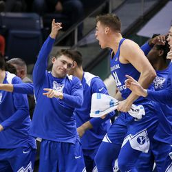 Brigham Young Cougars players react after a point against the Utah Utes at the Marriott Center in Provo on Saturday, Dec. 16, 2017.