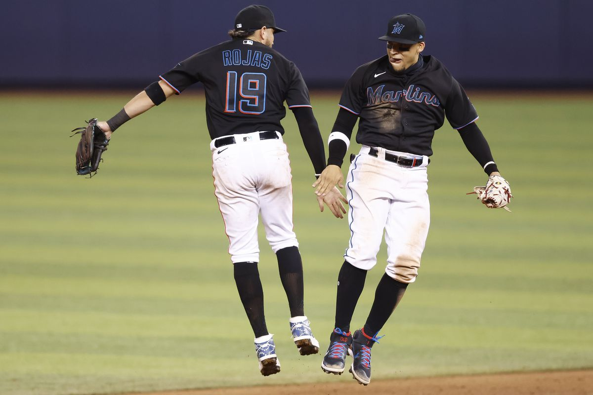 Miguel Rojas #19 and Isan Diaz #1 of the Miami Marlins celebrate after defeating the Milwaukee Brewers 6-1 at loanDepot park on May 07, 2021 in Miami, Florida.