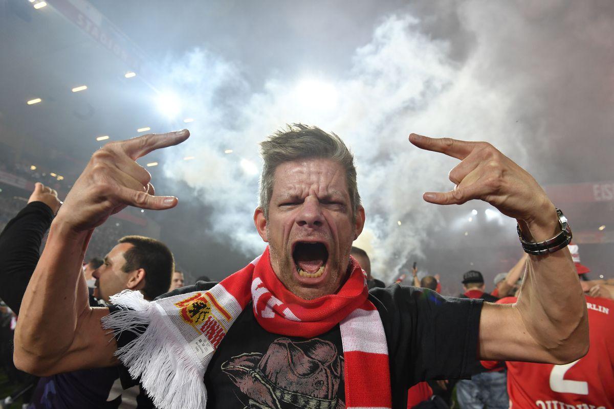 An Union Berlin's fan celebrates on the pitch after Union won in the German Bundesliga Relegation second-leg football match FC Union Berlin v VfB Stuttgart in Berlin, on May 27, 2019.