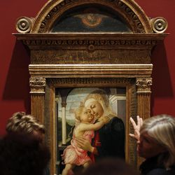 """People view Botticelli's oil on canvas entitled """"Madonna and Child"""" during a preview of """"Offering of the Angels: Treasures from the Uffizi Gallery"""" at the James A. Michener Museum, Friday, April 20, 2012, in Doylestown, Pa. The exhibit is scheduled to open Saturday."""