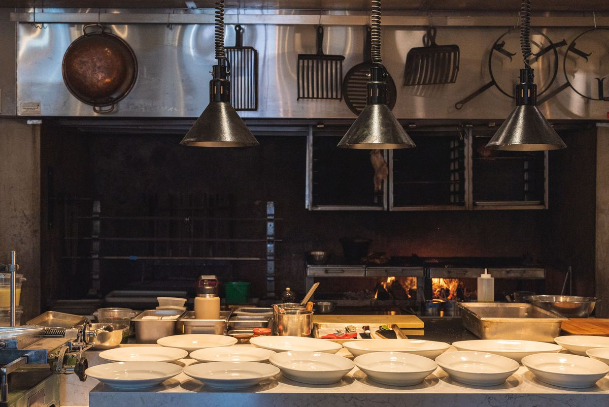 An open kitchen with plates lined up ready for service.