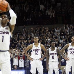 UConn's Tyler Polley (12), Antwoine Anderson (0), Terry Larrier (22) and Jalen Adams (4) watch Christian Vital (1) shoot a foul shot during the Columbia Lions vs UConn Huskies men's college basketball game at Gampel Pavilion in Storrs, CT on November 29, 2017.