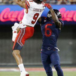 Utah Utes wide receiver Darren Carrington II pulls in a pass with Arizona Wildcats safety Demetrius Flannigan-Fowles defending in Tucson, Arizona, on Friday, Sept. 22, 2017. Utah beat Arizona 30-24.