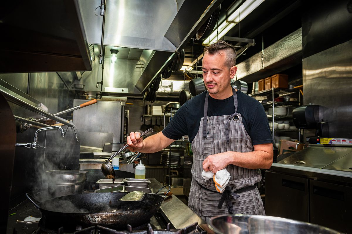 James Wozniuk at his happy place in front of a wok