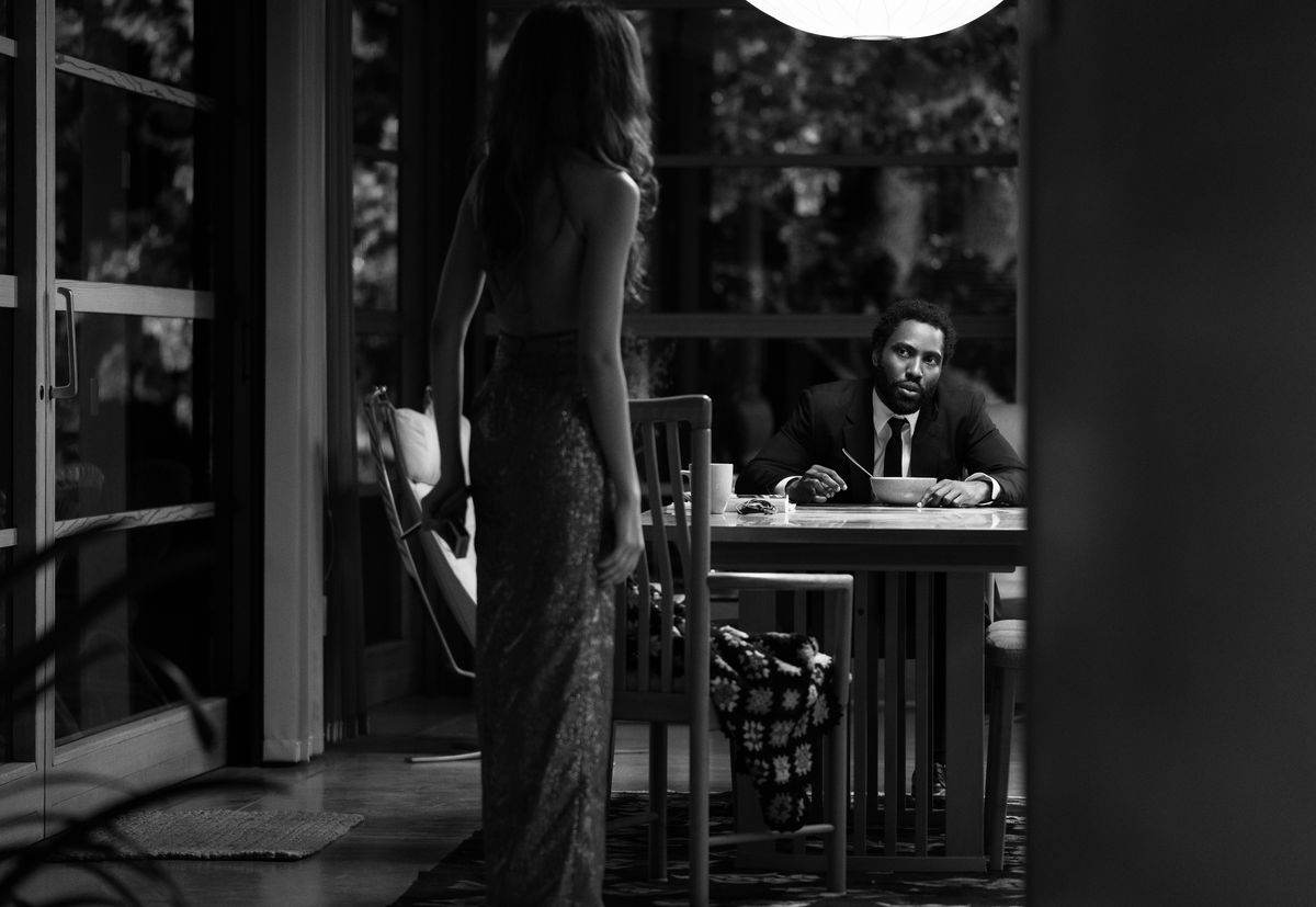 Zendaya, with her back to the camera, faces a seated John David Washington in Malcolm & Marie