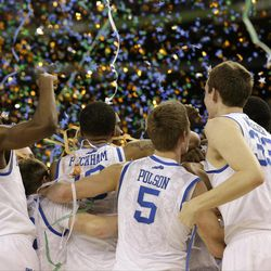 Kentucky players celebrate at the end of the NCAA Final Four tournament college basketball championship game against Kansas Monday, April 2, 2012, in New Orleans. Kentucky won 67-59.