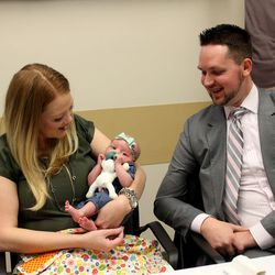 Arlee Gregerson holds her newborn, Lucy, as her husband, Ryan, looks on at the Intermountain Medical Center in Murray on Thursday, Dec. 17, 2015. Two days after delivering her first child, Arlee Gregerson nearly died. The Gregersons returned to the medical center to speak to reporters about Arlee's care at the center.