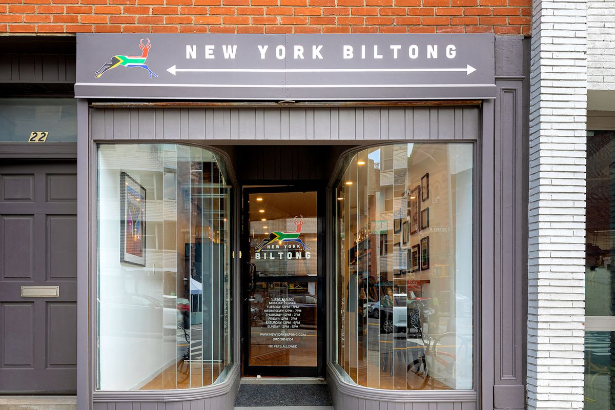 The exterior of a shop with glass windows and a sign that says New York Biltong
