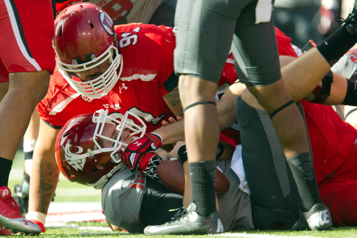 November 3, 2012; Salt Lake City, UT, USA; Washington State Cougars quarterback Jeff Tuel (10) is on the turf after being sacked by Utah Utes defensive tackle Tenny Palepoi (91) during the first half at Rice-Eccles Stadium.