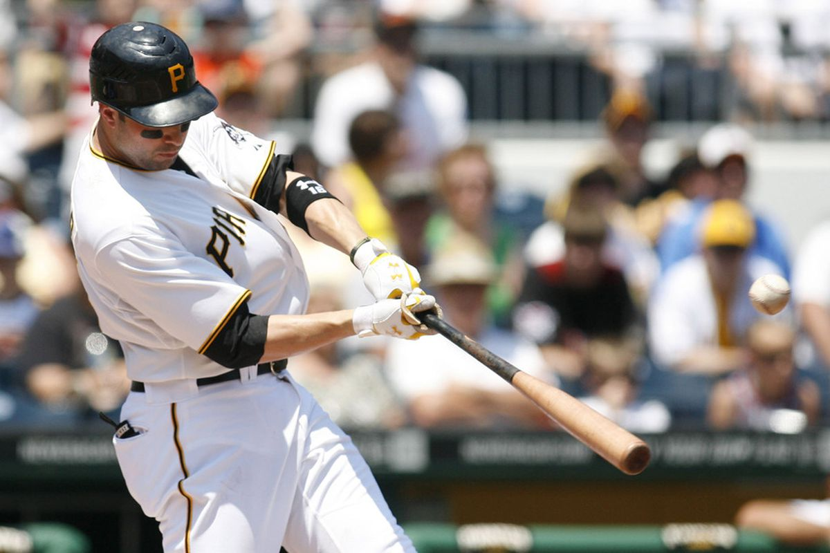 Pittsburgh, PA, USA; Pittsburgh Pirates second baseman Neil Walker (18) hits a single against the Kansas City Royals during the third inning at PNC Park. The Pittsburgh Pirates won 3-2. Mandatory Credit: Charles LeClaire-US PRESSWIRE