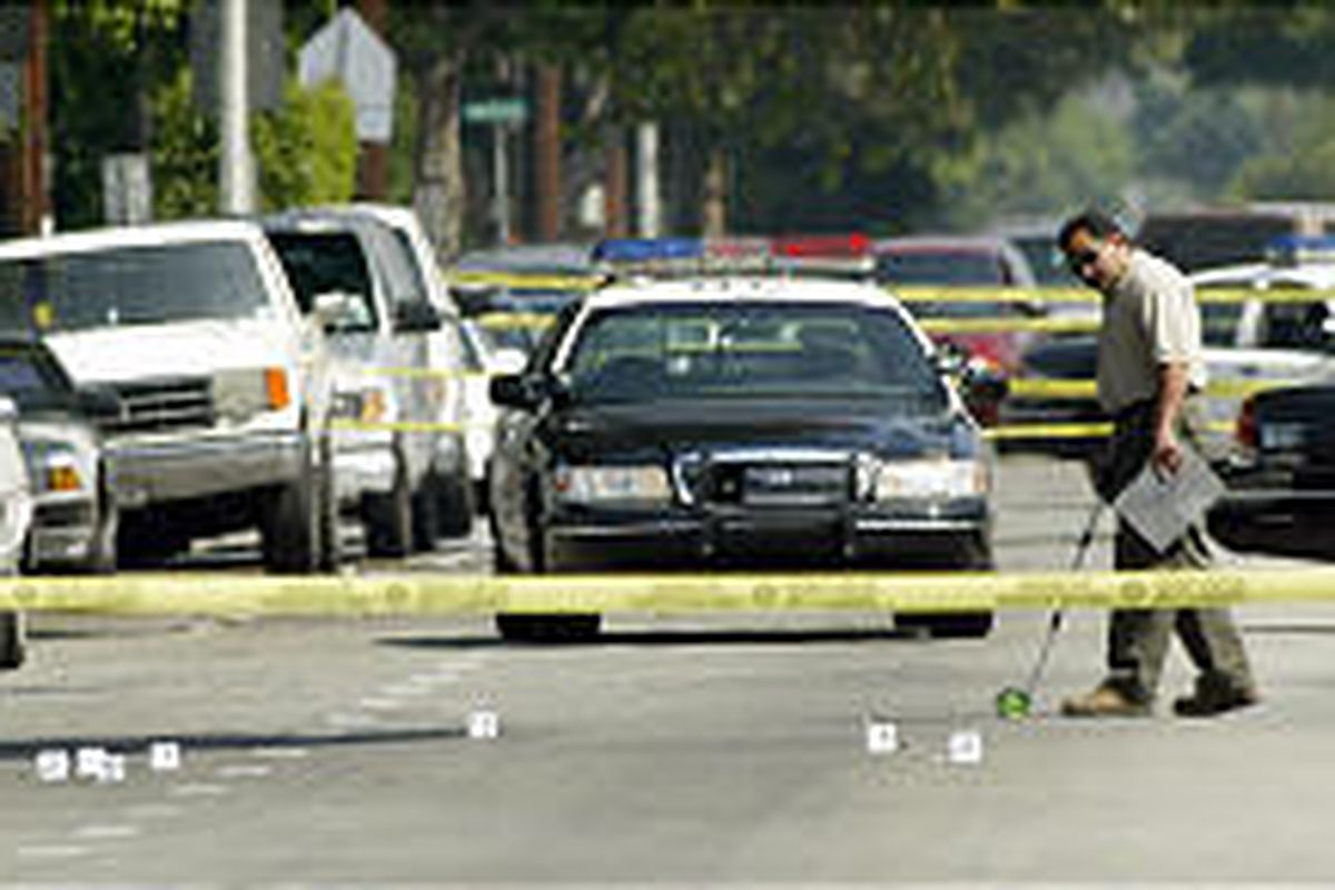 L.A. County sheriff's personnel investigate the site where the Yetunde Price, 31, was shot to death Sunday.