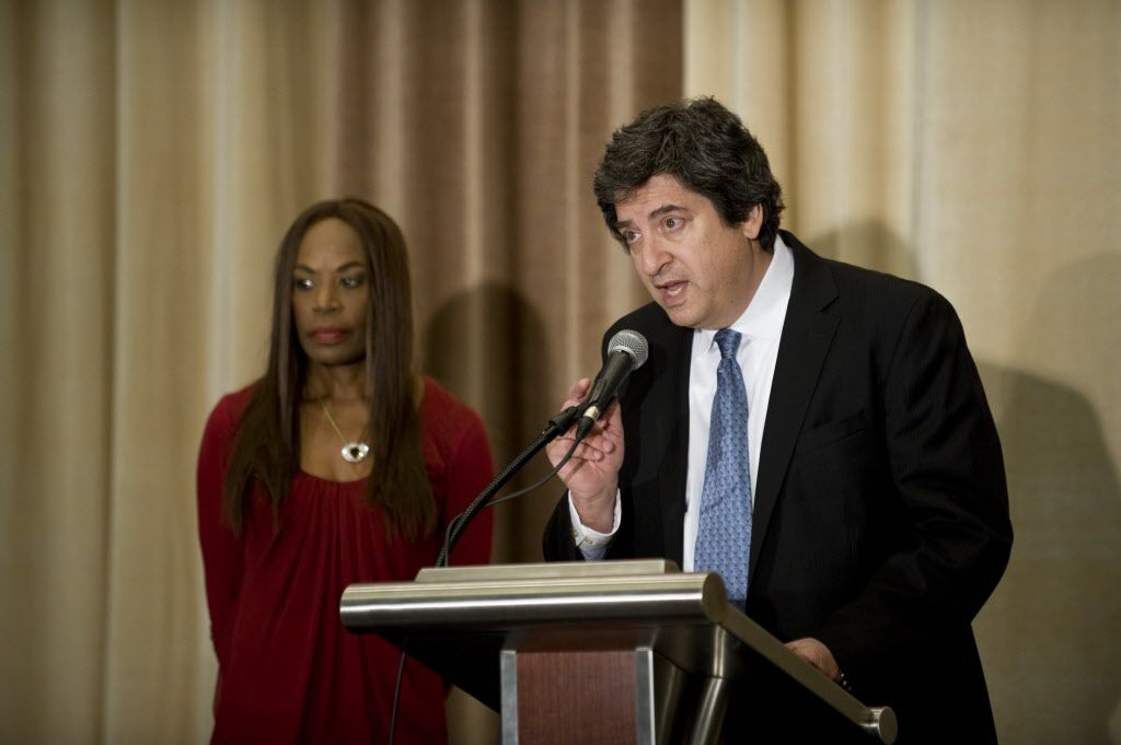 <small><strong> Family attorney Mark Bogen talks while Liz Banks, wife of baseball legend Ernie Banks stands behind him.   Richard A. Chapman/Sun-Times</strong></small>