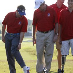 Retired First Lt. Brian Donarski, right, shows his prosthetic leg to Former President George W. Bush during the opening ceremony for the Bush Center Warrior Open in Irving, Texas, Monday, Sept. 24, 2012. The Warrior Open is a two-day golf tournament featuring members of the U.S. Armed Forces who were severely wounded during the global war against terrorism.