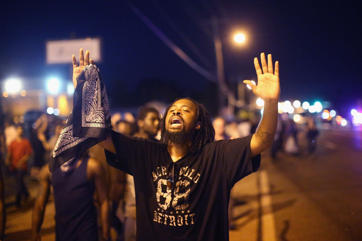 """""""Hands up, don't shoot"""" has become the unofficial motto of the Ferguson protests."""