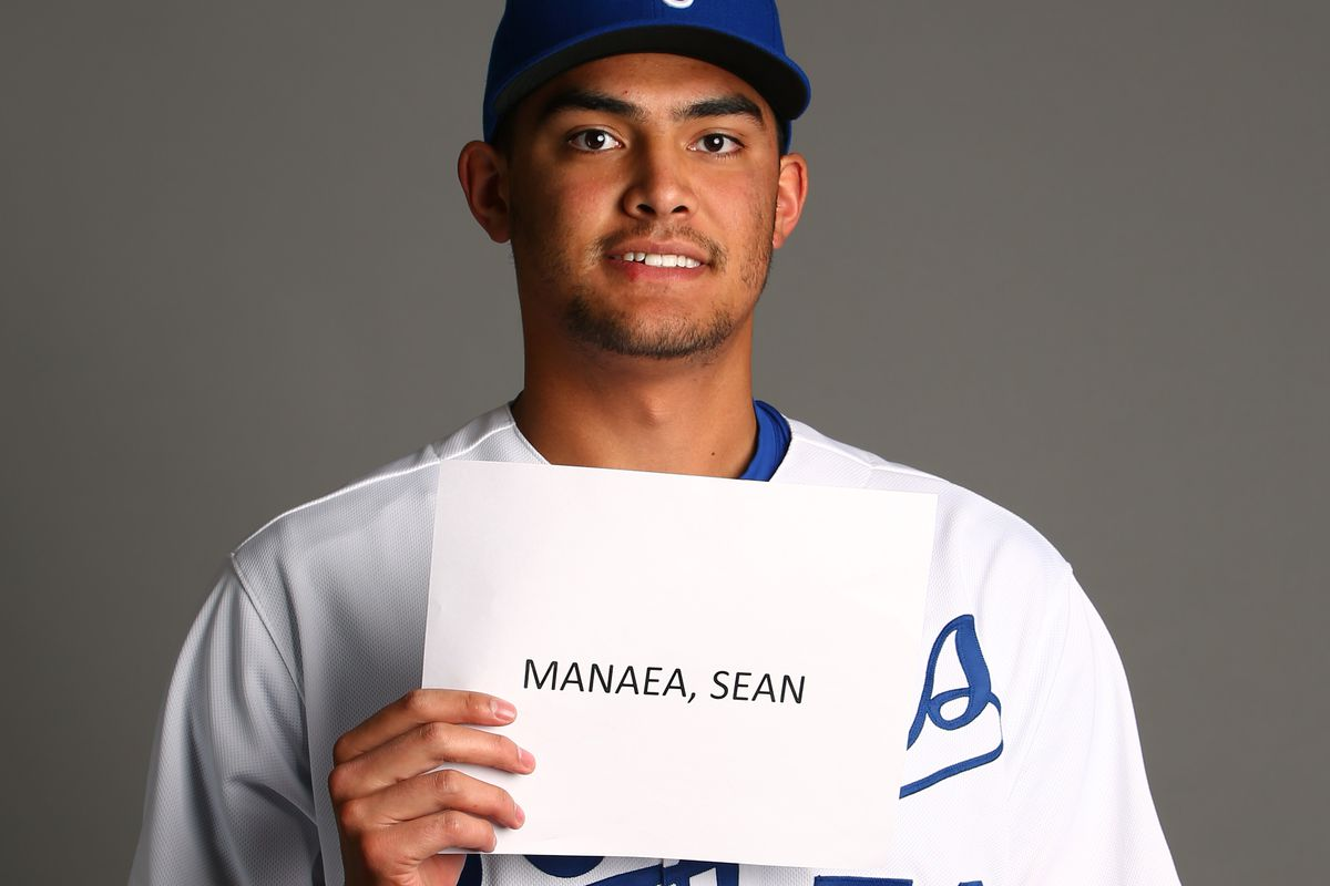 Note: He's using his non-pitching arm to hold up that sign. Smart man.