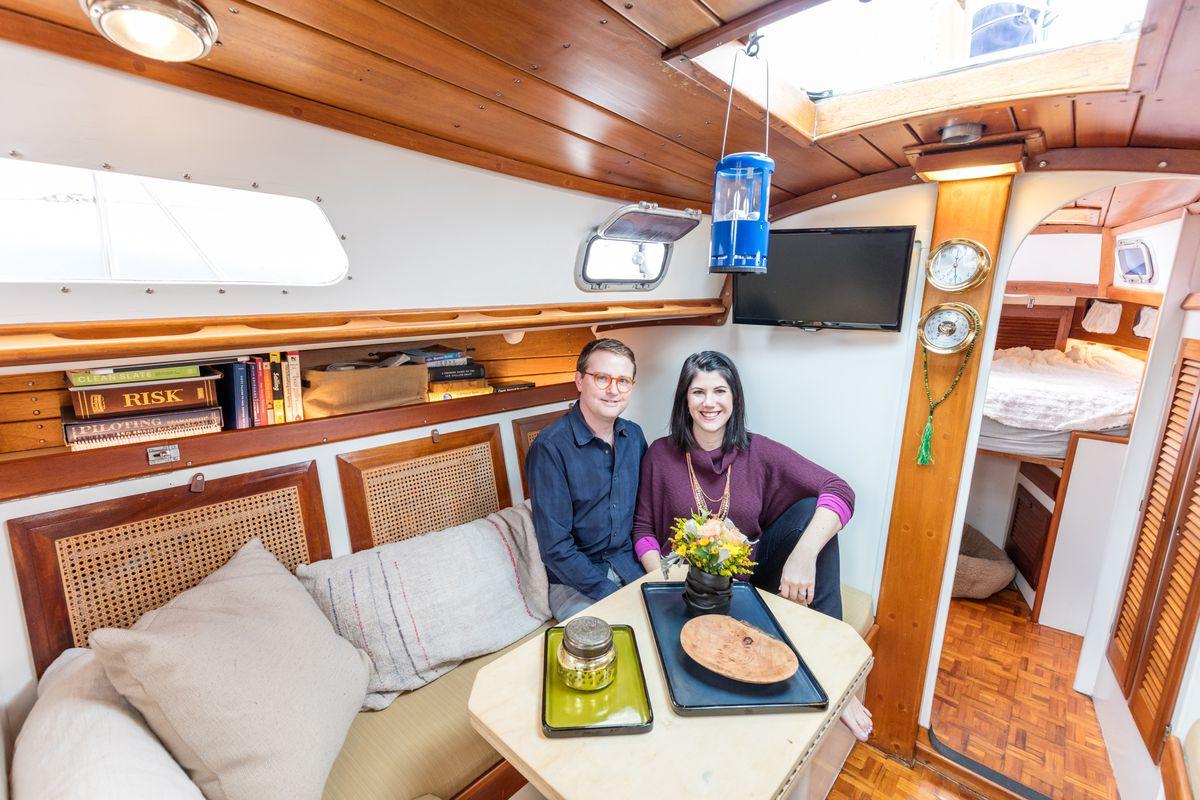 Victoria Fine and Jon Vidar aboard their sailboat