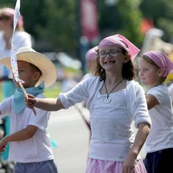 Eliza Hinton marches behind the Riverton North Stake float in the Days of '47 Youth Parade in Salt Lake City on Saturday, July 20, 2013.
