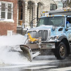 A plow truck clears snow on the side of the street on W. Addison St. in the Lakeview neighborhood, Tuesday, Feb. 16, 2021.