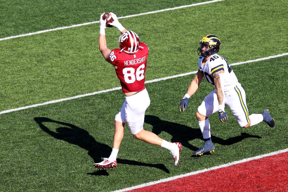 Peyton Hendershot of the Indiana Hoosiers catches a touchdown pass while being defended by Ben VanSumeren of the Michigan Wolverines during the second quarter at Memorial Stadium on November 07, 2020 in Bloomington, Indiana.