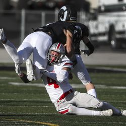 Spanish Fork defender Spanish Fork upends Highland quarterback Ashton Zwick during their 5A first round football playoff game at Highland at Highland High School in Salt Lake City on Friday, Oct. 23, 2020.