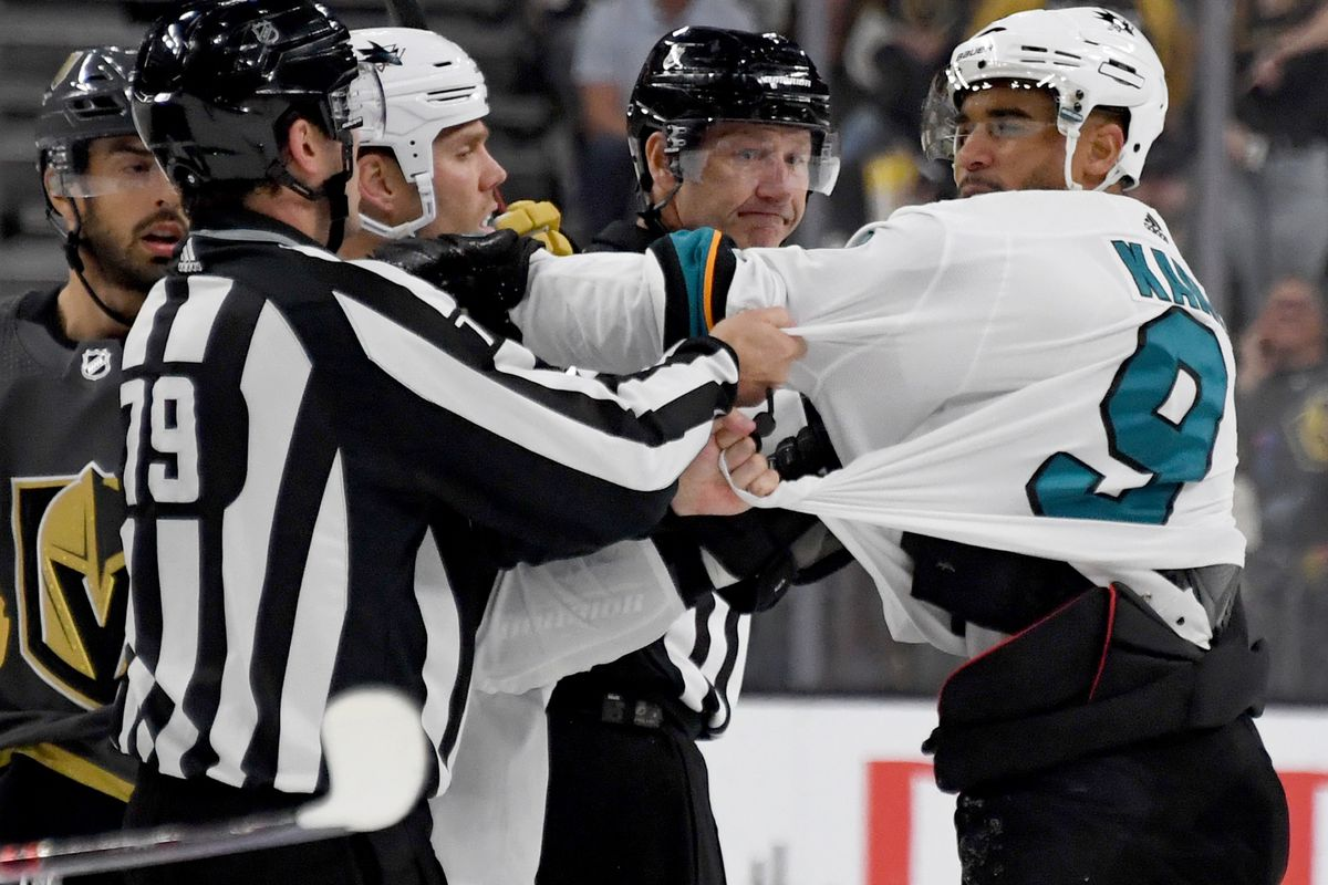 Evander Kane of the San Jose Sharks shoves linesman Kiel Murchison in the third period of the Sharks' preseason game against the Vegas Golden Knights at T-Mobile Arena on September 29, 2019 in Las Vegas, Nevada.