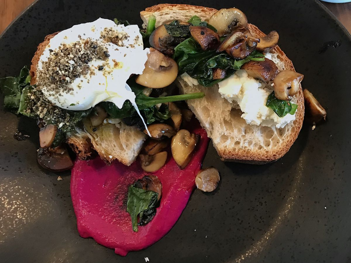 Mushroom tartine with a poached egg and beet hummus