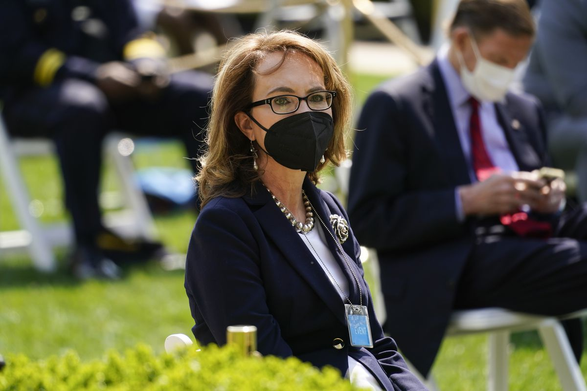 Former Rep. Gabby Gifford, D-Ariz., is seated before an event on gun violence prevention in the Rose Garden at the White House, Thursday, April 8, 2021, in Washington.