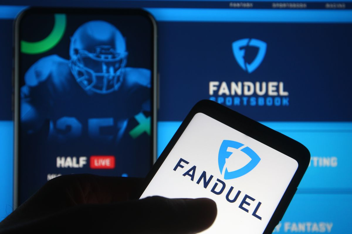 In this photo illustration the FanDuel logo of a sports...