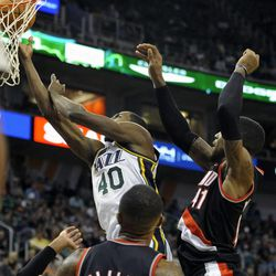 Utah Jazz small forward Jeremy Evans (40) drives to the basket in front of Portland Trail Blazers power forward Thomas Robinson (41) and Portland Trail Blazers point guard Mo Williams (25) in the second half of a game at the Energy Solutions Arena on Wednesday, October 16, 2013.