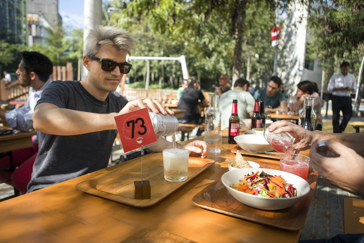 Andrés Bartos enjoys a beer at the picnic tables in the Poblenou superblock.