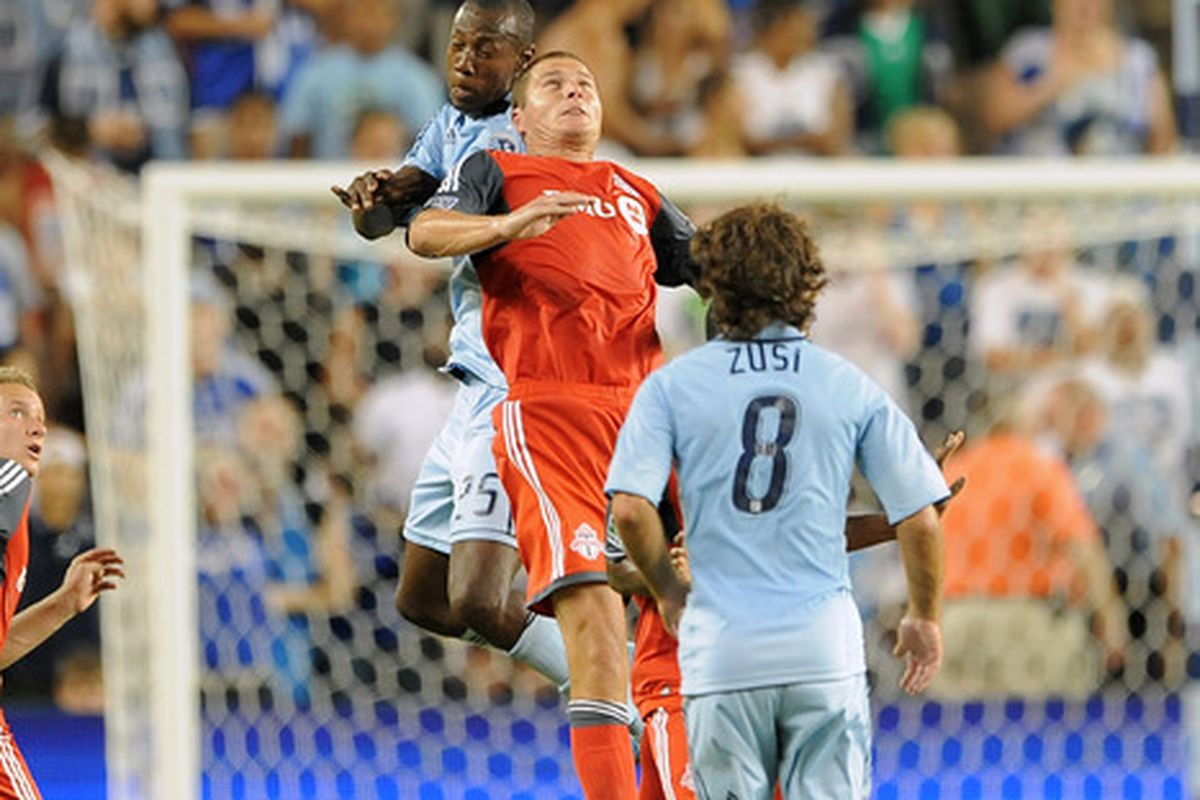 KANSAS CITY, KS - JULY 23:  Danny Koevermans #14 of Toronto FC heads the ball past Daneil Cyrus #25 of Sporting Kansas City on July 23, 2011 at LiveStrong Sporting Park in Kansas City, Kansas. (Photo by G. Newman Lowrance/Getty Images)