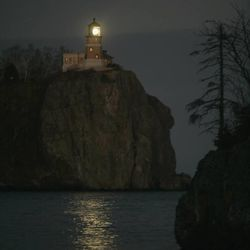 The Split Rock Lighthouse, in Two Harbors, Minn., shines its beacon during a special centennial commemoration of the completion of the lighthouse on Nov. 5, 2010. Usually the light is only illuminated on Nov. 10, to remember the sinking of the Edmund Fitzgerald. This rare fall lighting drew hundreds of spectators to watch and photograph the lighthouse.