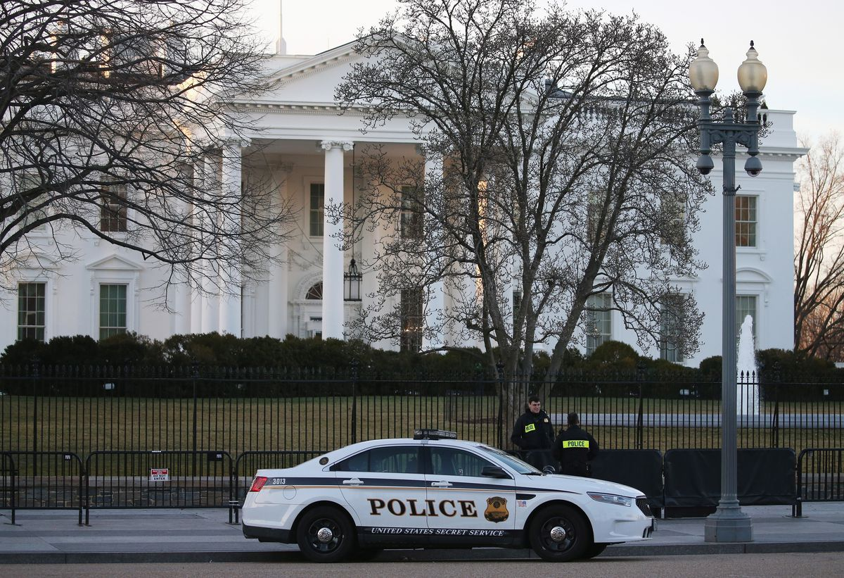 A police car in front of the White House.