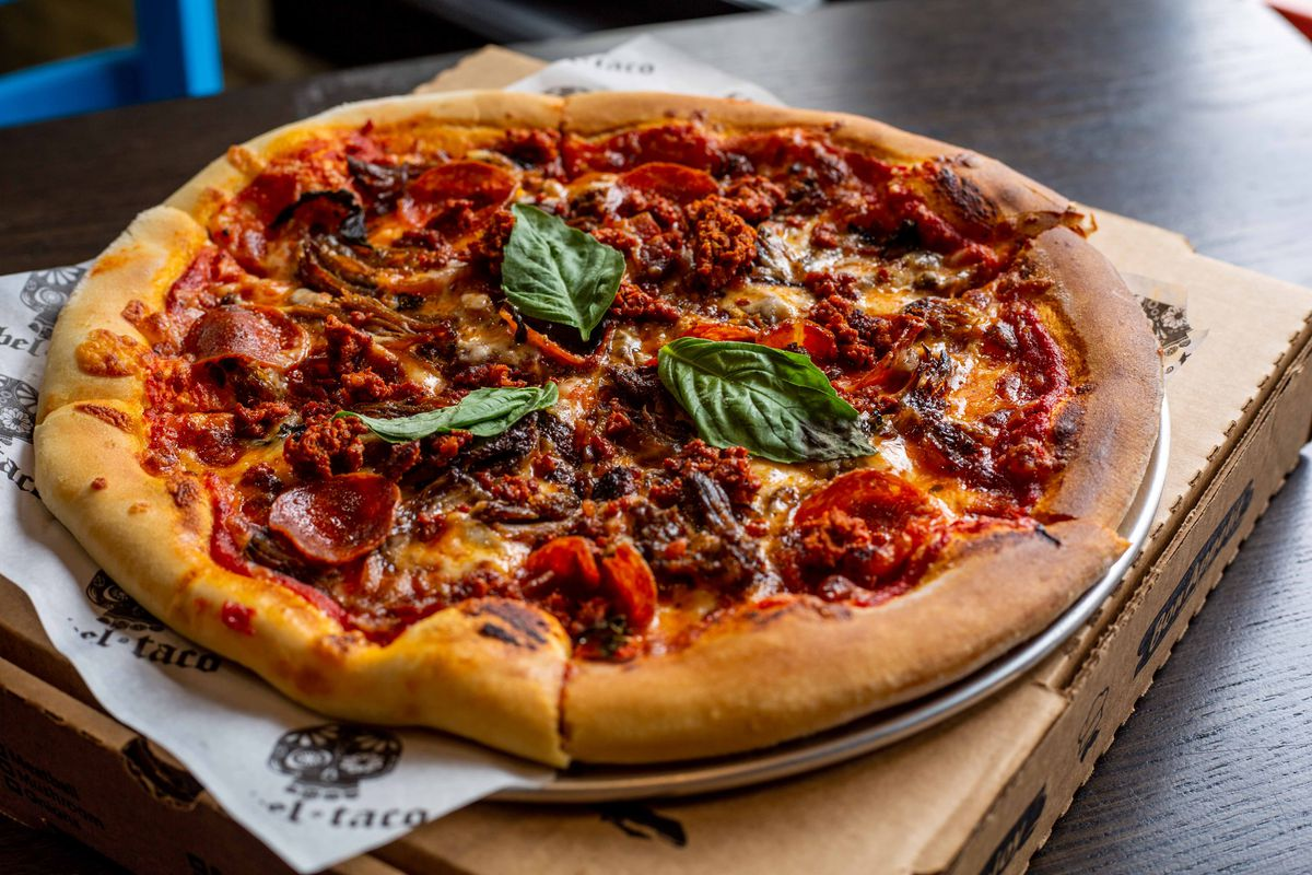 """The """"Meat Affair"""" pie at Rebel Margherita is a meaty compilation of barbacoa, Mexican chorizo, and pepperoni."""