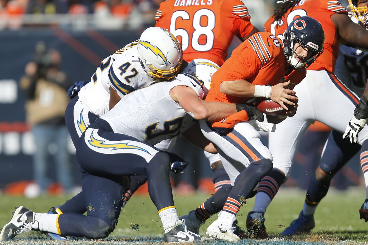 Joey Bosa of the Los Angeles Chargers sacks Mitchell Trubisky of the Chicago Bears late in the fourth quarter at Soldier Field on October 27, 2019 in Chicago, Illinois.