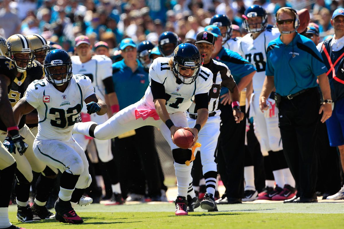 JACKSONVILLE, FL - OCTOBER 02:   Blaine Gabbert #11 of the Jacksonville Jaguars dives for yardage during a game against the New Orleans Saints at EverBank Field on October 2, 2011 in Jacksonville, Florida.  (Photo by Sam Greenwood/Getty Images)
