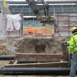 Plate being lowered into place to shore up the side of the excavation