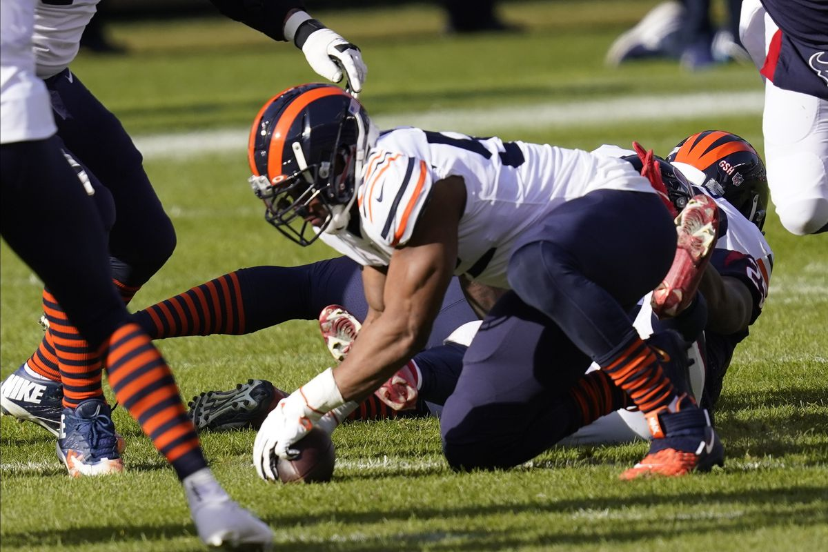 Bears linebacker Khalil Mack recovers a fumble after stripping the ball from Texans running back Duke Johnson in the first quarter Sunday at Soldier Field. The Bears won, 36-7.