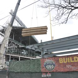 Materials being lifted in the right field bleachers -