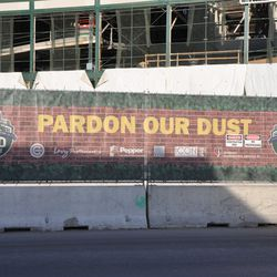 """Very faded """"Pardon Our Dust"""" sign -"""
