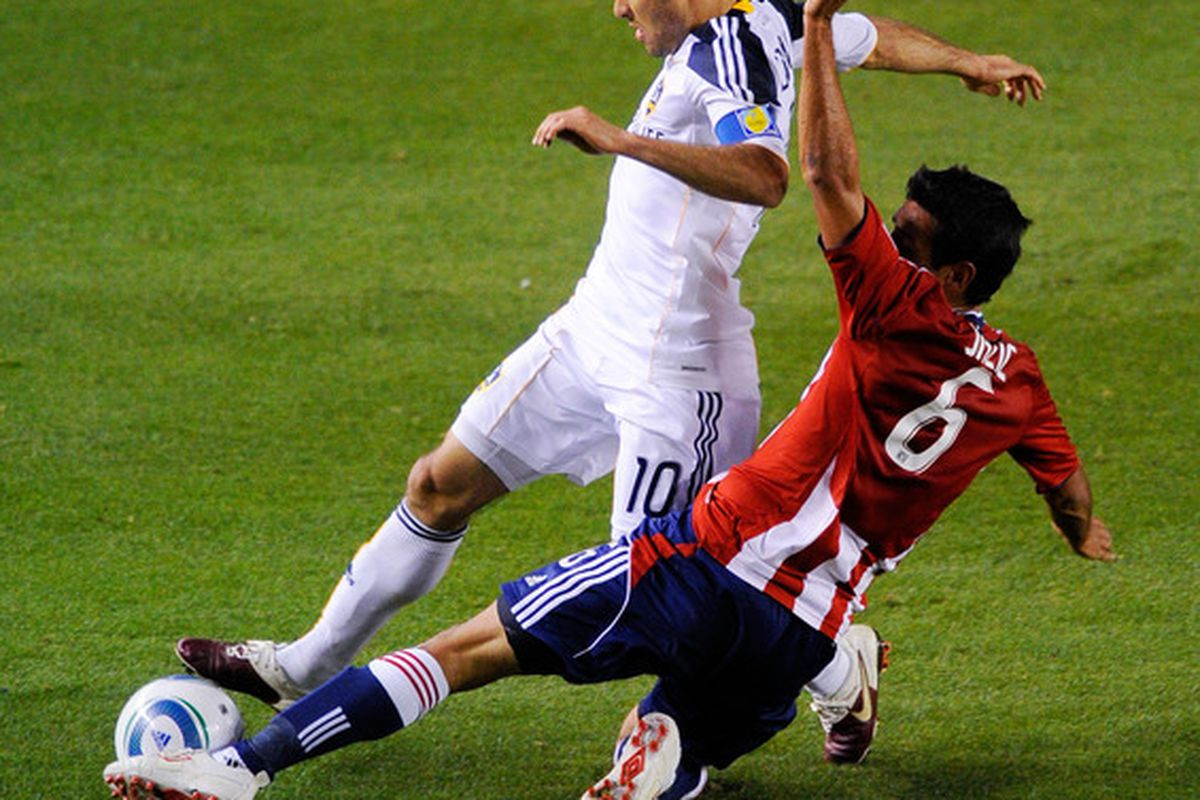 CARSON, CA - APRIL 01:  Landon Donovan #10 of the Los Angeles Galaxy and Ante Jazic #6 of Chivas USA battle for the ball during the first half of the MLS soccer match on April 1, 2010 in Carson, California.  (Photo by Kevork Djansezian/Getty Images)