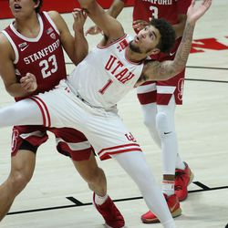 Utah Utes forward Timmy Allen (1) is blocked out by Stanford Cardinal forward Brandon Angel (23) in Salt Lake City on Thursday, Jan. 14, 2021. The Utes won 79-65.