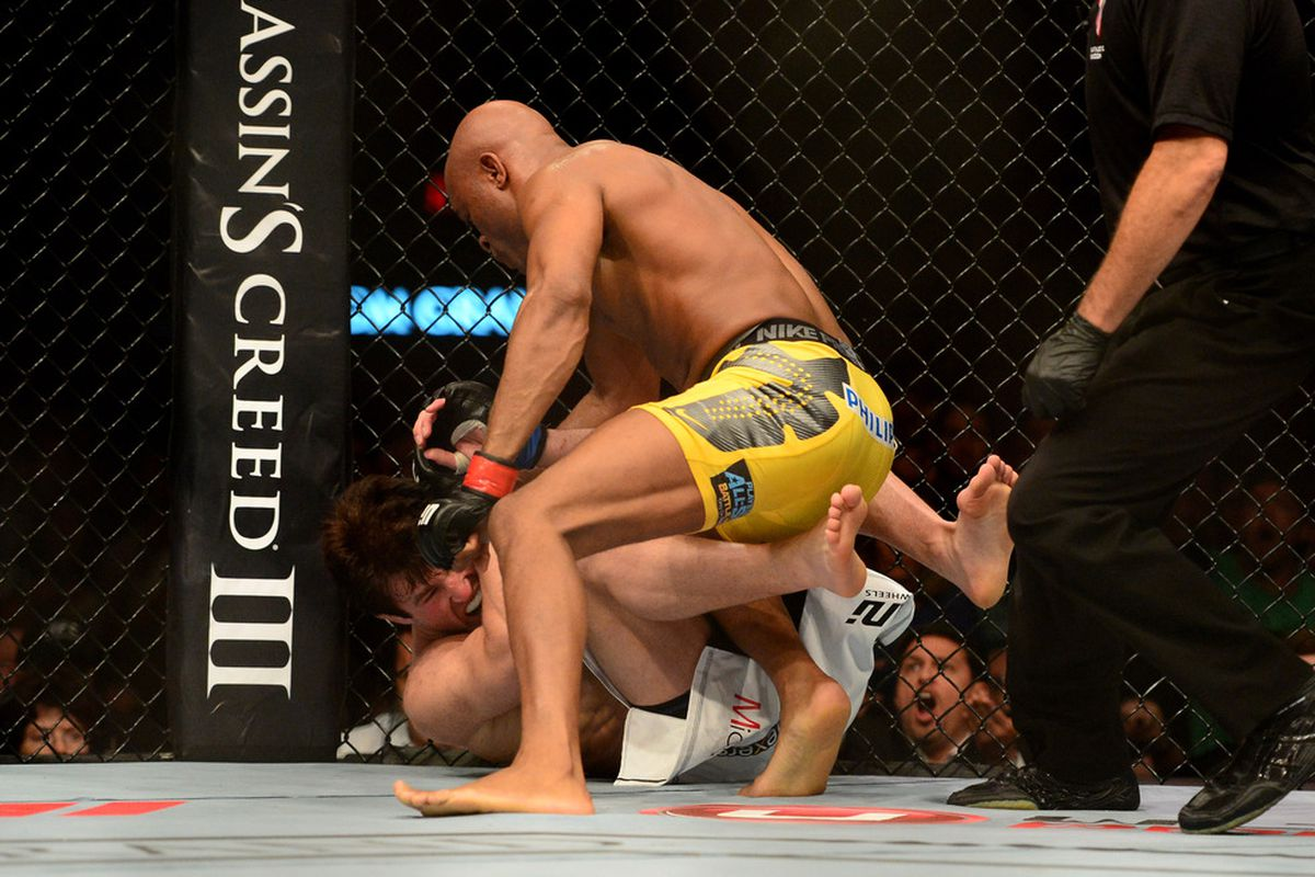 Jul. 7, 2012; Las Vegas, NV, USA; UFC fighter Anderson Silva (top) punches Chael Sonnen during a middleweight bout in UFC 148 at the MGM Grand Garden Arena. Photo Credit: Mark J. Rebilas-US PRESSWIRE